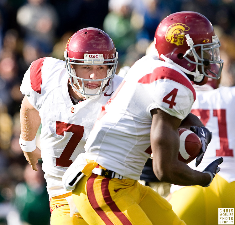 10/17/09 - South Bend, IN:  USC quarterback Matt Barkley hands off to running back Joe McKnight during the first possession of their game against Notre Dame at Notre Dame Stadium on Saturday.  USC won the game 34-27 to extend its win streak over Notre Dame to 8 games.  Photo by Christopher McGuire.