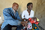 Both mother and child react as Mactivity Chima immunizes a child in Kalikumbi, Malawi, where the Maternal, Newborn and Child Health program of the Livingstonia Synod of the Church of Central Africa Presbyterian has helped families stay healthy.