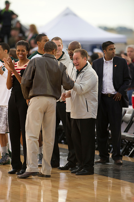 SAN DIEGO, CA - NOVEMBER 11, 2011: (L to R) First Lady of the United States Michelle Obama,  Barack Obama the 44th President of the United States and Michigan State head coach Tom Izzo during the Opening Ceremonies of the 2011 Quicken Loans Carrier Classic on the USS Carl Vinson prior to a game between the Michigan State Spartans and the North Carolina Tar Heels..(Photo by Robert Beck / ESPN)..- RAW FILE AVAILABLE -.- CMI000165176.jpg -