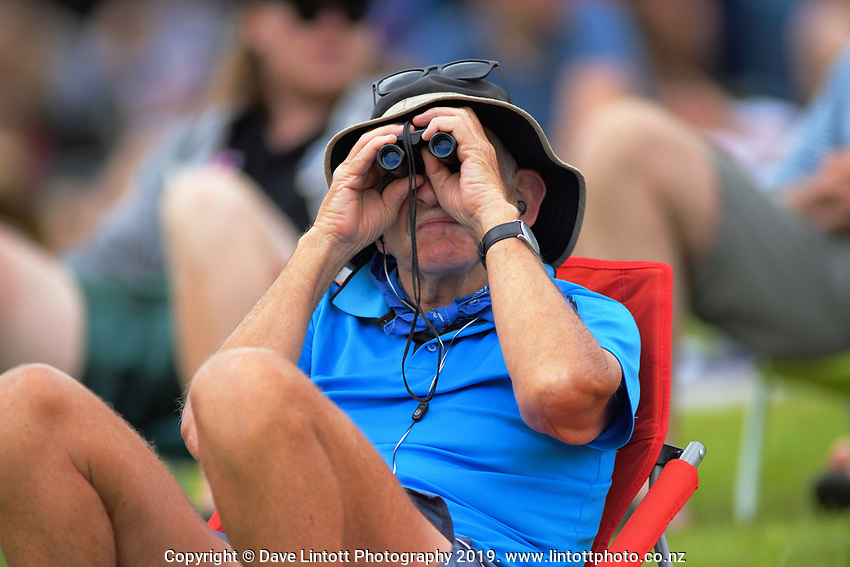 A fan watches through binoculars during day four of the international cricket 2nd test match between NZ Black Caps and England at Seddon Park in Hamilton, New Zealand on Friday, 22 November 2019. Photo: Dave Lintott / lintottphoto.co.nz