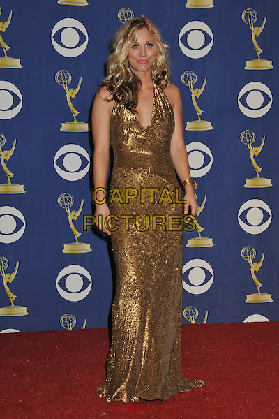 KALEY CUOCO.Attending the 61st Annual Primetime Emmy Awards held at NOKIA Theatre L.A. LIVE, Los Angeles, California, USA, .20th September 2009..pressroom press room emmys full length long maxi gold sequined halterneck sequins pink lipstick v-neck bracelet .CAP/ADM/BP.©Byron Purvis/Admedia/Capital Pictures