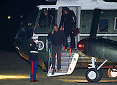 United States President Barack Obama salutes the Marine guard as he and first lady Michelle Obama arrive on the South Lawn of the White House in Washington, D.C. in the early morning hours of Wednesday, January 28, 2015.  The President and first lady returned from a State Visit to India and a visit to Saudi Arabia.<br /> Credit: Ron Sachs / Pool via CNP