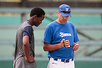 07 May 2010: Team France manager Sylvain Virey talks to Jean Antonio Samer during a tryout for Team France, in St Maarten, Netherlands Antilles.