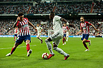 Real Madrid's Vinicius Jr. and Atletico de Madrid's Jose Maria Gimenez (L) and Juanfran Torres (R) during La Liga match between Real Madrid and Atletico de Madrid at Santiago Bernabeu Stadium in Madrid, Spain. September 29, 2018. (ALTERPHOTOS/A. Perez Meca)