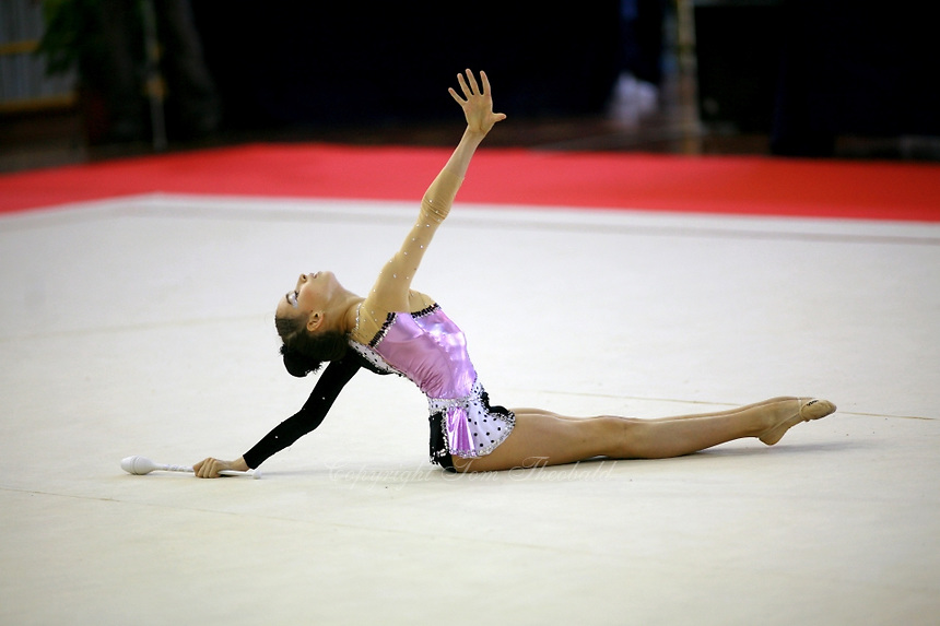 Cristina Lautaru of Romania begins clubs routine during junior All-Around competition at 2006 Trofeo Cariprato in Prato, Italy on June 17, 2006.  (Photo by Tom Theobald)