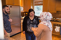 SEATTLE, WA-APRIL 17, 2017: Amanda Saab, along with her husband Hussein Saab, greet Anjana Agarwal, as she arrives for &quot;dinner with your Muslim neighbor&quot; at the home of Stefanie and Nason (cq) Fox in Seattle, WA on a return trip April 17th 2017. The couple now live in Detroit. <br />   <br /> (Photo by Meryl Schenker/For The Washington Post)