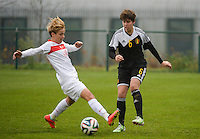20141126 - TUBIZE , BELGIUM : duel pictured between Belgian Isabelle Iliano (right) and Turkish Gülbin Hiz (left) during the Friendly female soccer match between Women under 19 / 21  teams of  Belgium and Turkey .Wednesday 26th November 2014 . PHOTO DAVID CATRY