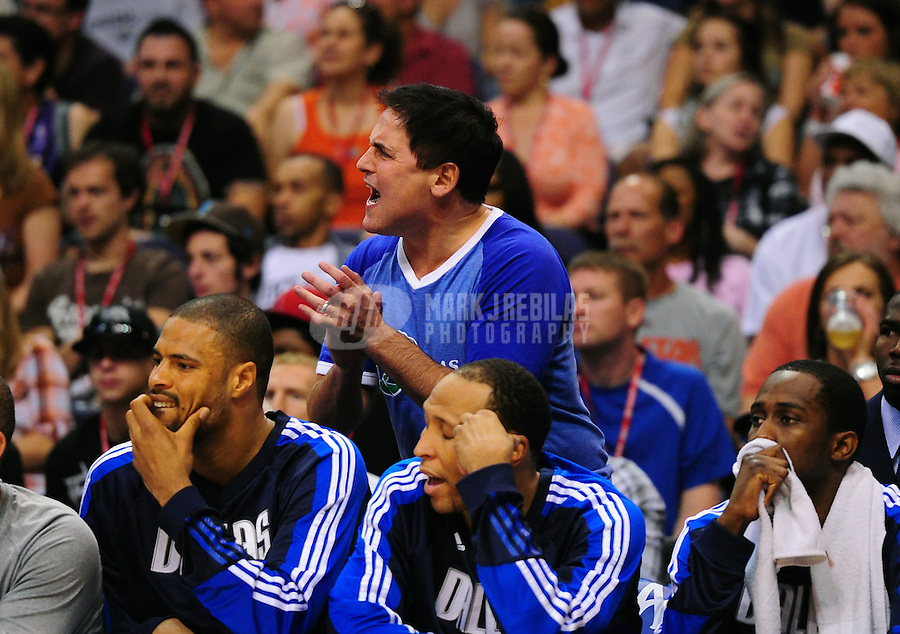 Mar. 27, 2011; Phoenix, AZ, USA; Dallas Mavericks owner Mark Cuban reacts in the first half against the Phoenix Suns at the US Airways Center. Mandatory Credit: Mark J. Rebilas-