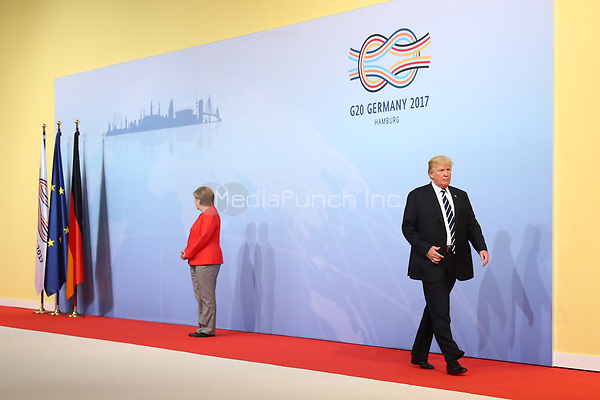 German chancellor Angela Merkel greets the American president Donald Trump at the G20 summit in Hamburg, Germany, 7 July 2017. The heads of the governments of the G20 group of countries are meeting in Hamburg on the 7-8 July 2017. Photo: Christian Charisius/dpa /MediaPunch ***FOR USA ONLY***