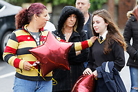 Pictured: Friends and family outside St John Lloyd School, in Llanelli, Carmarthenshire, UK. Thursday 12 September 2019<br /> Re: The family of a bullied pupil were joined by friends and held a minute's silence, a year after he hanged himself in school toilets.<br /> His heartbroken father Byron John claims his son Bradley, 14, would still be alive if the school had acted to stop the bullies.<br /> Bradley's 13-year-old sister Danielle found him dead in the toilet block at, an hour after going missing at St John Lloyd Roman Catholic School in Llanelli, South Wales, UK.