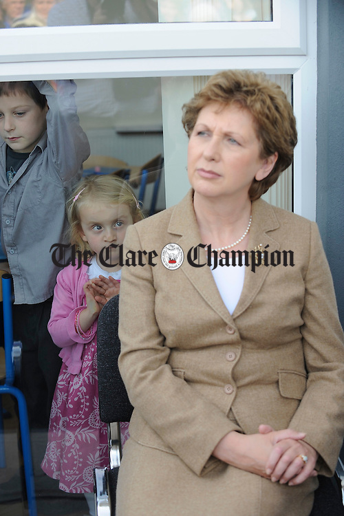 Little Aiveen Coombes looks up at President Mc Aleese at  the official opening of the Spraoi Family Resource Centre at Miltown Malbay. Photograph by John Kelly.
