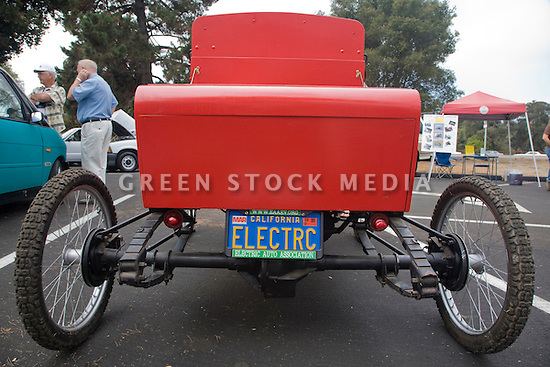 A rear view of the first electric vehicle owned by an Electric Auto Association member. The car is a 1904 'Merry' Oldsmobile replica, built by Bill Palmer and son in 1967 and currently owned by Pat Parmelee. At an Electric Vehicle Rally in Palo Alto, hosted by the Silicon Valley Chapter of the Electric Auto Association. Palo Alto, California, USA