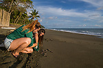 Olive Ridley Sea Turtle (Lepidochelys olivacea) conservationists releasing hatchlings, Osa Conservation, Osa Peninsula, Costa Rica