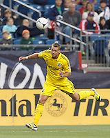 Columbus Crew defender Josh Williams (3) heads the ball. In a Major League Soccer (MLS) match, the New England Revolution tied the Columbus Crew, 0-0, at Gillette Stadium on June 16, 2012.