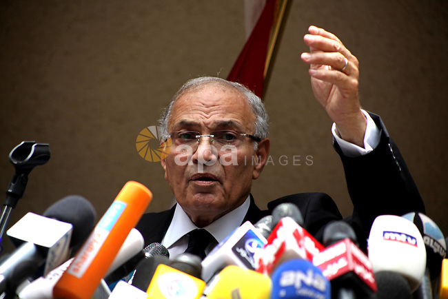 "Egyptian presidential candidate Ahmed Shafiq speaks to the media during a press conference at his office in Cairo, Egypt, Saturday, May 26, 2012. Egyptian presidential candidate Ahmed Shafiq paid tribute Saturday to the ""glorious revolution"" that toppled Hosni Mubarak, a dramatic turn-around for the former regime official who fought his way into the runoff elections by appealing to public disenchantment with last year's uprising. Photo by Ashraf Amra"