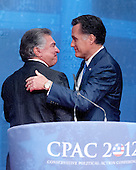 Al Cardenas, Chairman, the American Conservative Union and former Governor Mitt Romney (Republican of Massachusetts), a candidate for the 2012 Republican Party nomination for President of the United States, after Cardenas' introduction at the 2012 CPAC Conference at the Marriott Wardman Park Hotel in Washington, D.C. on Friday, February 10, 2012..Credit: Ron Sachs / CNP