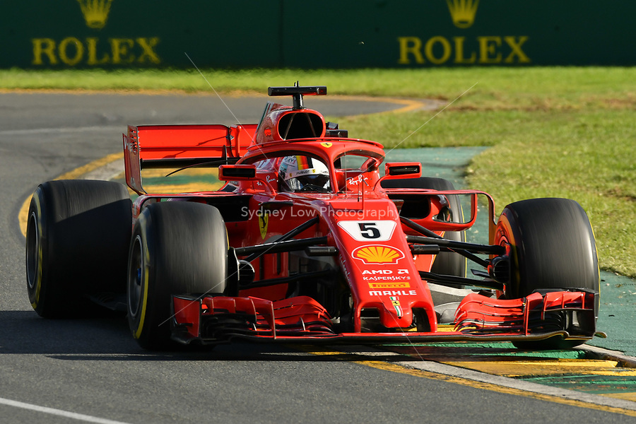 March 25, 2018: Sebastian Vettel (DEU) #5 from the Scuderia Ferrari team rounds turn two of the 2018 Australian Formula One Grand Prix at Albert Park, Melbourne, Australia. Photo Sydney Low