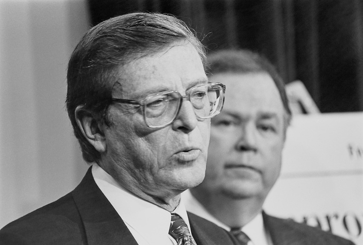 """Congressional reformers Sen. Pietro Vichi """"Pete"""" Domenici, R-N.M., and Sen. David Lyle Boren, D-Okla., at press conference, also attended by Rep. Willis David """"Bill"""" Gradison, R-Ohio, House of Representatives Member, and Rep. Lee Herbert Hamilton, D- Ind., House Foreign Affairs Committee Chairman, on Wednesday afternoon. March 25, 1992 (Photo by Maureen Keating/CQ Roll Call)"""