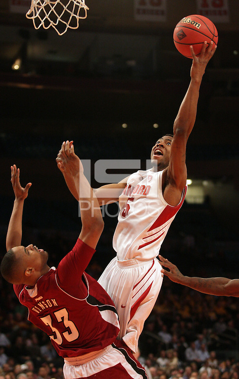 Stanford's Chasson Randle (5) takes a shot as UMass' Terrell Vinson (33) defends during the second half in a semifinal game of the NIT at Madison Square Garden, New York, N.Y., Tuesday, March 27, 2012. Stanford defeated UMass 74-64.