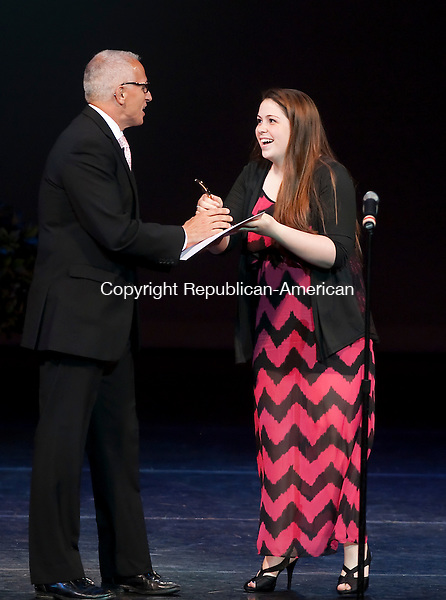 WATERBURY, CT-052814JS24--Woodland Regional High School's Katie Steinacher, right, receives the Halo for Best Costume Design and Execution for &quot;The Miracle Worker&quot; and &quot;Grease&quot; from Palace CEO Frank Tavera during the 11th annual Seven Angels Theatre's Halo Awards Wednesday at the Palace Theater in Waterbury. <br /> Jim Shannon Republican-American