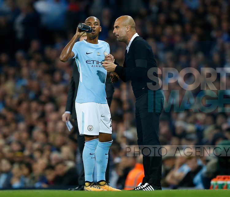 Fernandinho of Manchester City receives instructions from Josep Guardiola manager of Manchester City during the Premier League match at the Eithad Stadium, Manchester. Picture date 21st August 2017. Picture credit should read: Simon Bellis/Sportimage