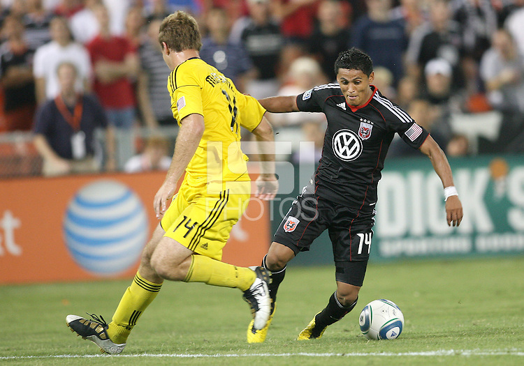 Andy Najar #14 of D.C. United swerves past Chad Marshall #14 of the Columbus Crew during a US Open Cup semi final match at RFK Stadium on September 1 2010, in Washington DC. Columbus won 2-1 aet.