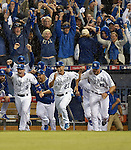 Royals team group,<br /> OCTOBER 5, 2014 - MLB :<br /> Johnny Giavotella, Norichika Aoki and Erik Kratz of the Kansas City Royals celebrate after winning the American League Division Series (ALDS) Game 3 against the Los Angeles Angels at Kauffman Stadium in Kansas City, Missouri, United States. (Photo by AFLO)