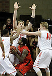 SIOUX FALLS, SD - MARCH 15: Prescott Williams #5, Isaac Sevlie #55 and Aaron Lien #14 from Minnesota State University Moorhead surround TJ White #12 from Central Missouri in the second half of their NCAA Regional game Sunday evening at the Sanford Pentagon in Sioux Falls, SD.  (Photo by Dave Eggen/Inertia)