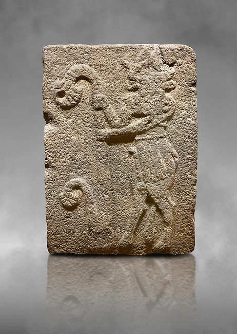 Hittite monumental relief sculpted orthostat stone panel from Water Gate Basalt, Karkamıs, (Kargamıs), Carchemish (Karkemish), 900-700 B.C. Anatolian Civilisations Museum, Ankara, Turkey. Bull-man holding the trunk of the tree. The waist-down part of the figure is in the form of a bull. <br /> <br /> On a grey art background.