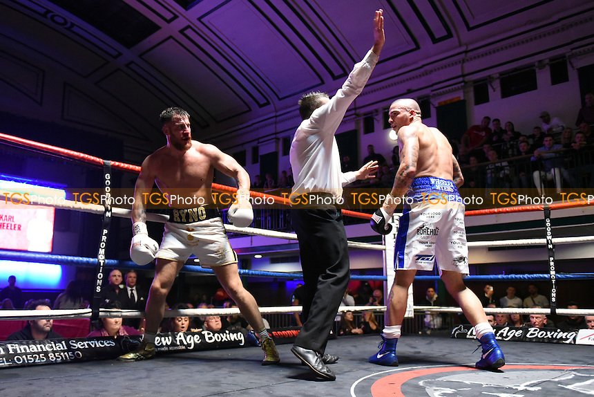 Karl Wheeler (white/blue shorts) defeats Ryan Crawford during a Boxing Show at York Hall on 3rd December 2016