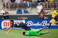 Antoine Hoppenot (29) of the Philadelphia Union flies over Toronto FC goalkeeper Milos Kocic (30). The Philadelphia Union defeated Toronto FC 3-0 during a Major League Soccer (MLS) match at PPL Park in Chester, PA, on July 8, 2012.