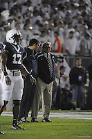27 September 2008:  Penn State QBs coach Jay Paterno talks to his father, Penn State head coach Joe Paterno, as they watch QB Daryll Clark (17).  The Penn State Nittany Lions defeated the Illinois Fighting Illini 38-24 September 27, 2008 at Beaver Stadium in State College, PA..