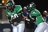 Farmingdale No. 40 Kevin Eversley, left, takes a handoff from quarterback No. 9 Anthony Burriesci and rushes for a 9-yard touchdown in the second quarter of a Nassau County varsity football Conference I semifinal against East Meadow at Hofstra University on Saturday, Nov. 14, 2015.<br /> <br /> James Escher