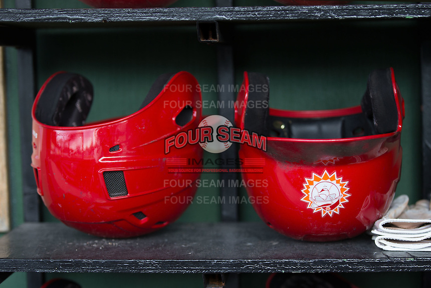 Hagerstown Suns batting helmets sit in the visitors dugout prior to the game against the Kannapolis Intimidators at Kannapolis Intimidators Stadium on May 6, 2016 in Kannapolis, North Carolina.  The Intimidators defeated the Suns 5-3.  (Brian Westerholt/Four Seam Images)