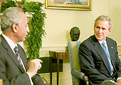 Washington, D.C. - December 16, 2005 -- United States President George W. Bush meets the Ambassador to the United Nations from Iraq  Samir Sumaidaie in the Oval Office at the Ambassador stopped by to brief the President on the elections held in Iraq on December 15, 2005.<br /> Credit: Ron Sachs - Pool via CNP