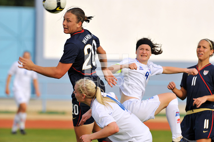 Abby Wambach wins a header vs. Rakel Honnudottir and Katrin Jonsdottir of Iceland.  The USWNT defeated Iceland (2-0) at Vila Real Sto. Antonio in their opener of the 2010 Algarve Cup on February 24, 2010.