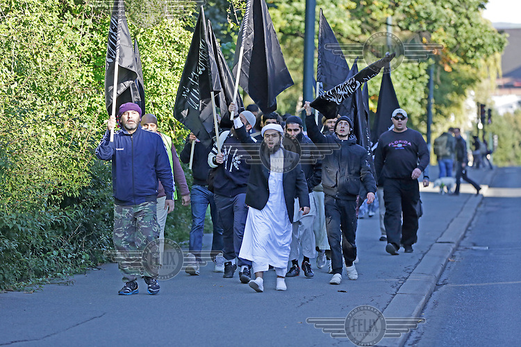 Radical muslims protest  a film mocking Islam outside the US embassy in Oslo, Norway. The gathering was small and passed peacefully.<br /> Omar Cheblal (left) has since been received a deportation order from Norway. BASTIAN ALEXIS VASQUEZ  (center, white headwear) is as of jan 2015 presumed killed in Syria According to family members quoted in Norwegian media Omar Cheblal was killed in Iraq, near Mosul, nov/des 2015.