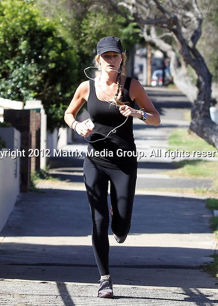 23 OCTOBER 2012 SYDNEY AUSTRALIA ..NON EXCLUSIVE ..Storm Uechtritz (girlfriend of Ronan Keating) takes a run through the streets of Bondi...*No internet without clearance*.MUST CALL PRIOR TO USE ..+61 2 9211-1088.Matrix Media Group.Note: All editorial images subject to the following: For editorial use only. Additional clearance required for commercial, wireless, internet or promotional use.Images may not be altered or modified. Matrix Media Group makes no representations or warranties regarding names, trademarks or logos appearing in the images.