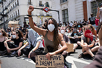 MADRID, SPAIN - JUNE 7: People sit at Puerta del Sol square during the demonstration organized in support of George Floyd and against the racism on June 07 2020, in Madrid, Spain. This demonstration, which began at the USA Embassy, has been produced in the middle of de escalation plans due to COVID-19 outbreak in Spain. The death of George Floyd by police in United States has caused protests against institutional racism and boosted the Black Live Matter movement across the country. It has created an anti-racism movement in multiples cities of Europe as well. (Photo by Sergio Belena/VIEWpress via Getty Images).