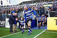 Matt Garvey of Bath Rugby, mascot in hand, leads his team onto the field. Aviva Premiership match, between Bath Rugby and Harlequins on November 25, 2017 at the Recreation Ground in Bath, England. Photo by: Patrick Khachfe / Onside Images