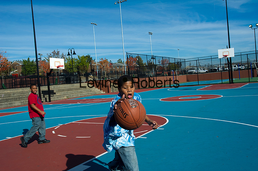 Kids playing basketball at the basketball courts.  Jesse Allen Park Phase II Opening Celebration, Newark, NJ on Wednesday, October 17, 2012.  (© Frances M. Roberts)