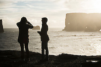Tourists on the Dyrholaey Peninsula at sunset, near Vik, South Iceland (Sudurland)