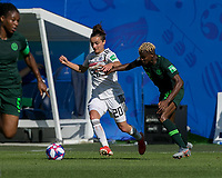 GRENOBLE, FRANCE - JUNE 22: Lina Magull #20 of the German National Team dribbles at midfield as Uchenna Kanu #12 of the Nigerian National Team defends during a game between Nigeria and Germany at Stade des Alpes on June 22, 2019 in Grenoble, France.