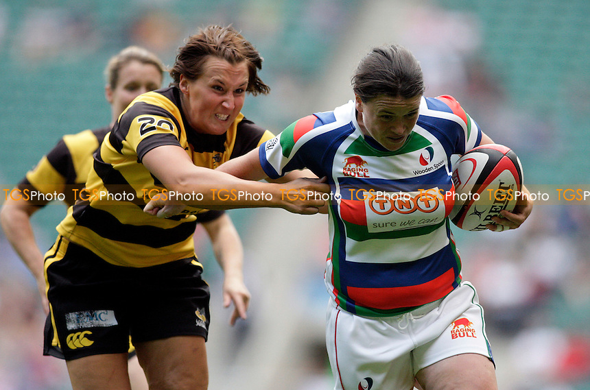Jackie Shiels of Wooden Spoon(R) breaks past Natalie Binstead of Golden Waps in the Women's Final - Middlesex Charity Sevens Rugby at Twickenham Stadium - 09/07/11 - MANDATORY CREDIT: Helen Watson/TGSPHOTO - Self billing applies where appropriate - 0845 094 6026 - contact@tgsphoto.co.uk - NO UNPAID USE.