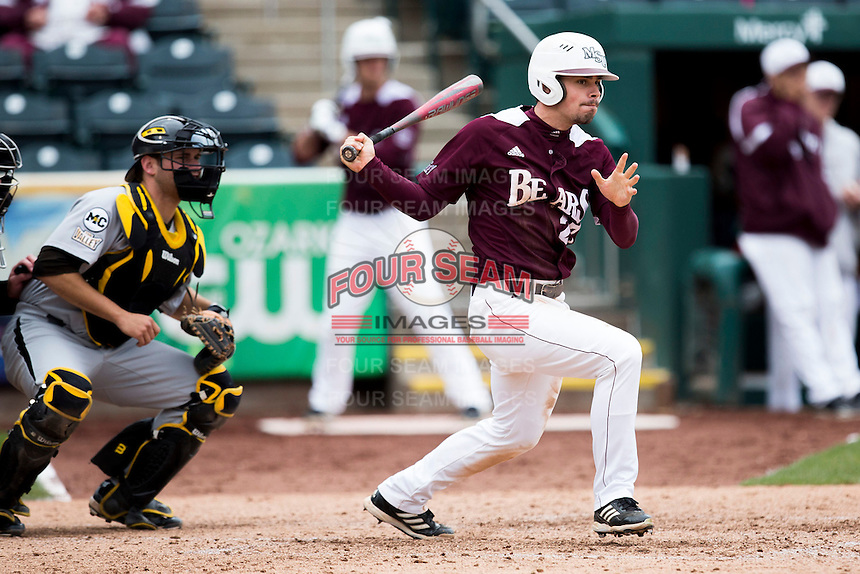 Dylan Becker #27 of the Missouri State Bears follows through his swing after making contact on a pitch during a game against the Wichita State Shockers at Hammons Field on May 5, 2013 in Springfield, Missouri. (David Welker/Four Seam Images)