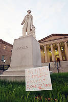 JUL 06 Lincoln Statue Outside DC Court of Appeals Has Sign Placed Next to Statue