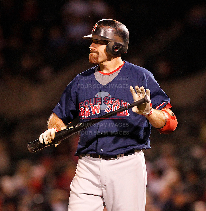 Boston Red Sox outfielder designated hitter Kevin Youkilis #46 reacts to a pitch while playing in a rehab assignment game with the Pawtucket Red Sox against the Rochester Red Wings  at Frontier Field on August 30, 2011 in Rochester, New York.  Rochester defeated Pawtucket 8-6.  (Mike Janes/Four Seam Images)