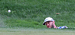 Cromwell, CT-23 JUNE 23 2017-062317MK07 Graham Delaet chips out the sand trap along the 18th green Friday afternoon at the 2017 Travelers Championship at the TPC River Highlands in Cromwell.  Michael Kabelka / Republican-American