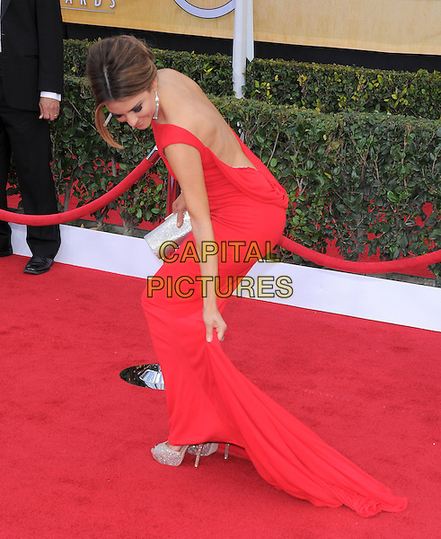Maria Menounos.Arrivals at the 19th Annual Screen Actors Guild Awards at the Shrine Auditorium in Los Angeles, California, USA..27th January 2013.SAG SAGs full length red dress backless side bending crouching fixing adjusting looking down train.CAP/DVS.©DVS/Capital Pictures.