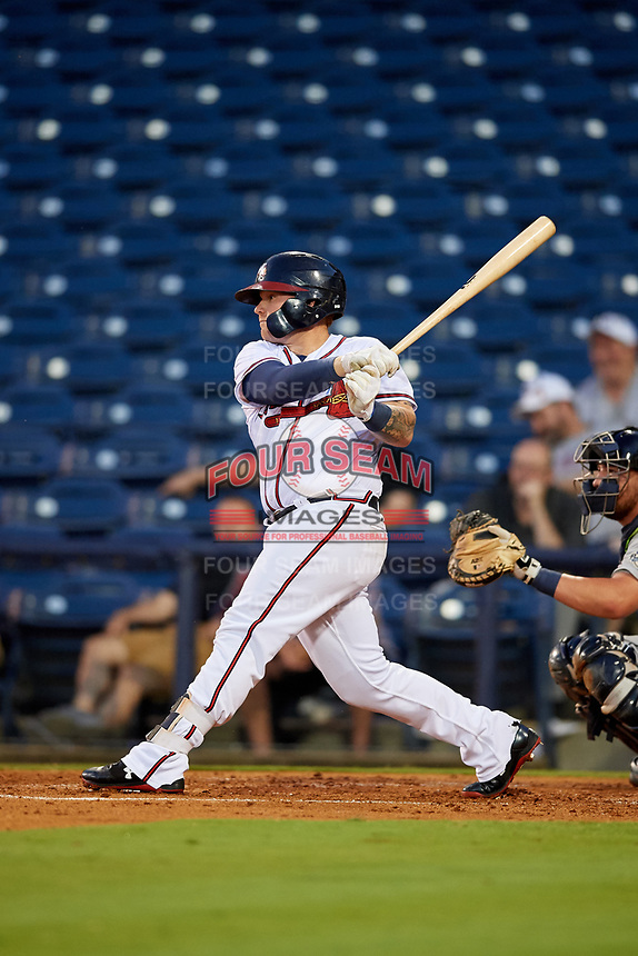 Mississippi Braves designated hitter Tyler Marlette (30) follows through on a swing in front of catcher Michael Barash (16) during a game against the Mobile BayBears on May 7, 2018 at Trustmark park in Pearl, Mississippi.  Mobile defeated Mississippi 5-0.  (Mike Janes/Four Seam Images)